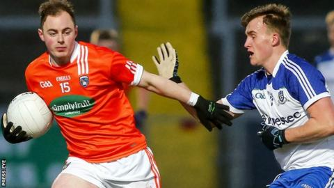 Armagh's Conor Martin in possession against Niall Rooney of Monaghan
