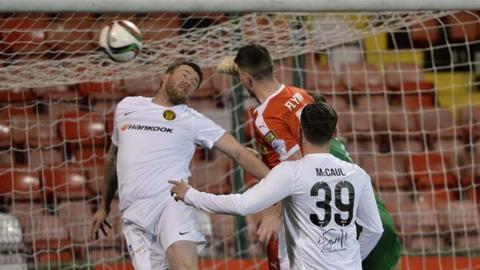 Action from Cliftonville against Carrick Rangers at Solitude