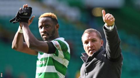 Celtic striker Moussa Dembele has a laugh with manager Brendan Rodgers