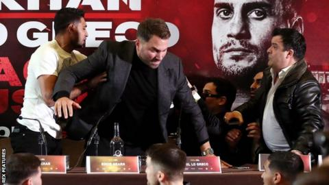 Amir Khan throws water at Phil Lo Greco during heated press conference