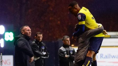 Rob Hall celebrates his goal for Oxford against Oldham
