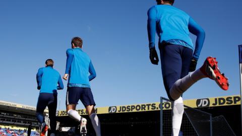 Tottenham warm up