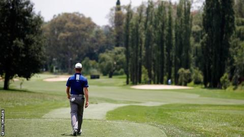 Brandon Stone of South Africa walks down the fairway after he hits his tee shot on the 3rd hole during Day Three of the Joburg Open at Royal Johannesburg