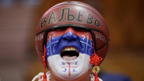 Wuhan, China, September 6: A Serbia fan getting into the mood before their Fiba Basketball World Cup match against Puerto Rico (Photo by Jason Lee/Reuters).