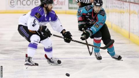 Mark Garside battles with Scott Aarssen in Saturday's game at the SSE Arena