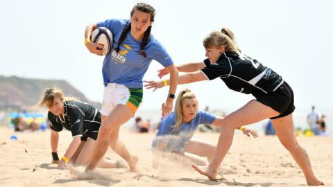 EXMOUTH, ENGLAND - JUNE 29: Competitors play touch rugby during the South West Beach Rugby 2019 on June 29, 2019 in Exmouth, England. (Photo by Dan Mullan/Getty Images)