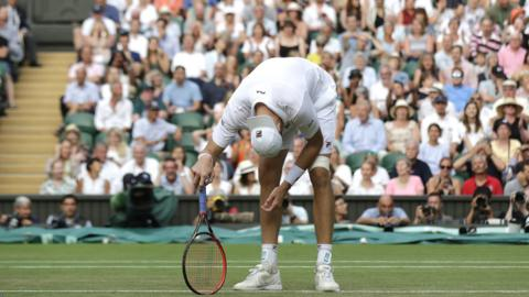 John Isner reacts to losing the men's Wimbledon semi-final against Kevin Anderson