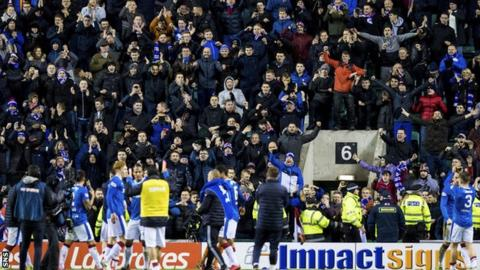 Rangers fans and players celebrate beating Hibernian