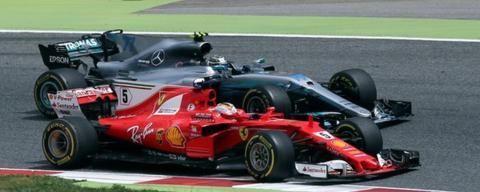 Sebastien Vettel passes Valtteri Bottas