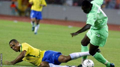 Brazil's Luis Fabiano challenges John Utaka of Nigeria