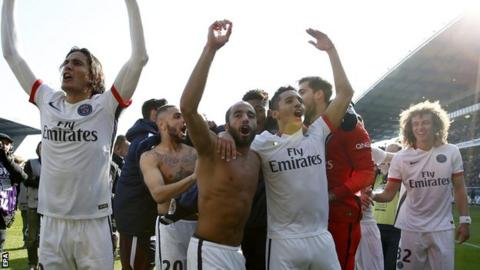 Paris St-Germain players celebrate winning the 2016 Ligue 1 title after an emphatic 9-0 win at Troyes