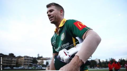 David Warner walks off the field