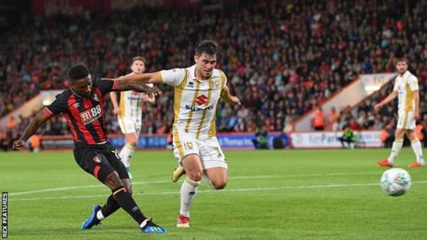 Jermain Defoe in action against MK Dons