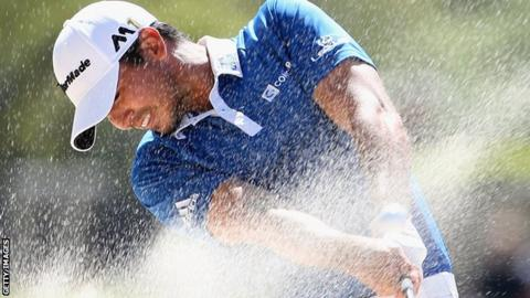Jason day plays out of a bunker