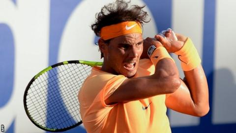 Rafael Nadal plays a backhand
