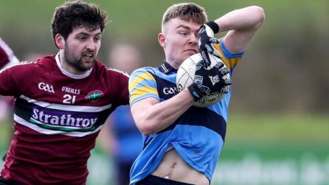 Ciaran Mac Iomhar of St. Mary's closes in to challenge UCD's Conor McCarthy during the 2017 Sigerson Cup final