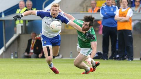 Monaghan's Kieran Hughes and Barry Mulrone of Fermanagh vie for possession during the Ulster Football semi-final at Breffni Park