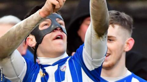 Brad Lyons of Coleraine celebrates his goal against Carrick Rangers