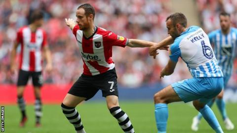 Ryan Harley playing for Exeter City