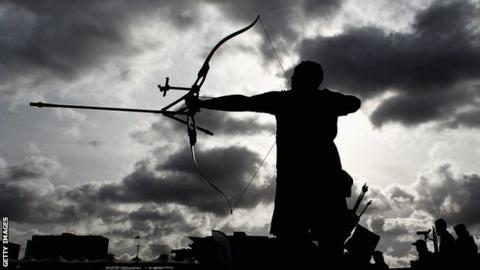 An archer gets ready to fire an arrow