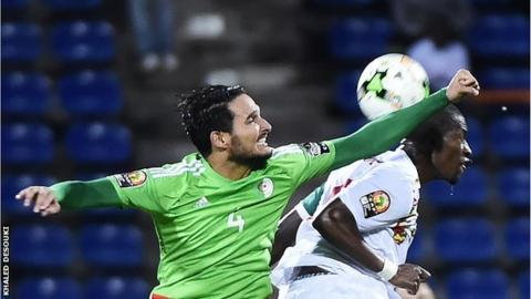 Algeria defender Liassine Cadamuro-Bentaiba challenges Senegal goalscorer Papakouli Diop