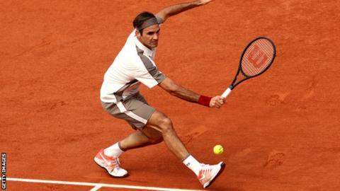 Roger Federer hits a backhand