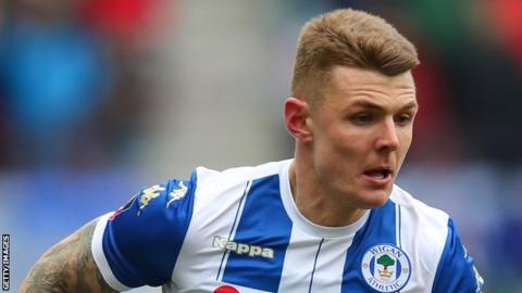 Max Power plays for Wigan in the FA Cup in 2018