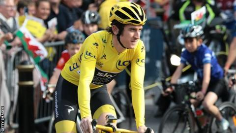 Tour de France winner Geraint Thomas wears the yellow jersey as he cycles through Cardiff at his homecoming parade