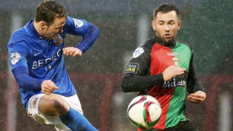 Glenavon's Andy Hall in action against Niall Henderson of Glentoran
