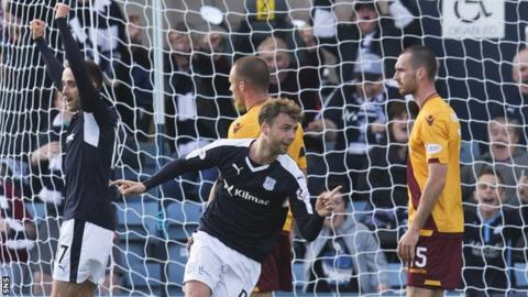 Dundee's Rory Loy wheels away after scoring