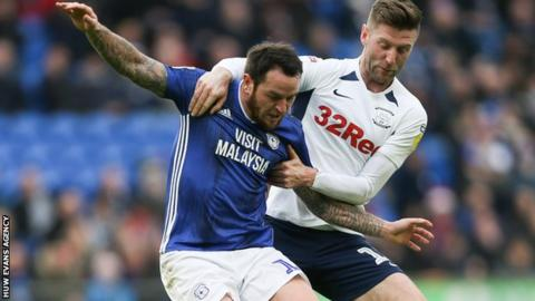 Lee Tomlin of Cardiff City is brought down by Preston North End's Paul Gallagher