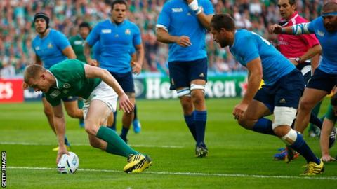 Keith Earls of Ireland scores their first try during the 2015 Rugby World Cup Pool D match between Ireland and Italy at the Olympic Stadium