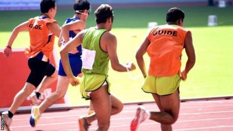 Visually-impaired runners with guide runners