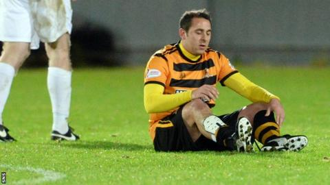 Michael Chopra sits injured in his last Alloa appearance