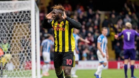 Issac Success celebrates scoring against Huddersfield