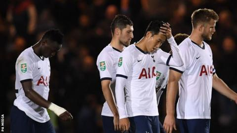 Tottenham players look dejected after defeat by League Two side Colchester United