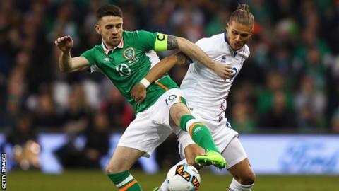 Robbie Brady battles with Iceland's Rurik Gislason