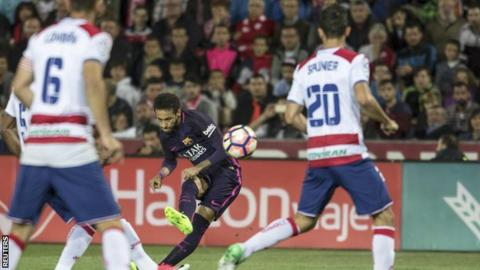 Neymar takes a shot for Barcelona against Granada