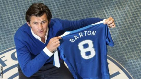 Joey Barton shows off his new Rangers jersey