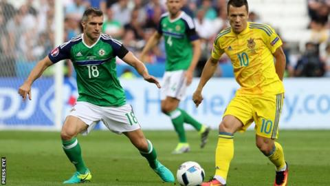 Aaron Hughes closes in on Ukraine's Yevhen Konoplyanka during the 2-0 win at Euro 2016