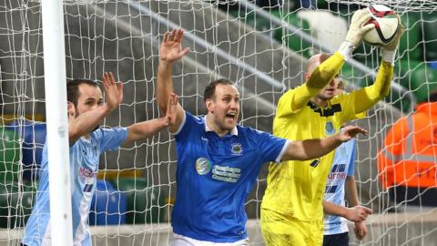Has it crossed the line or not - Linfield striker Guy Bates claims it has but Alan Blayney is of a different opinion and the referee agrees with the United stopper