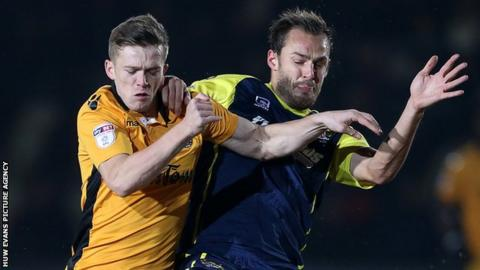 Rhys Healey (left) in action for Newport County