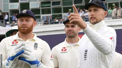 England captain Joe Root with team-mates James Anderson and Jonny Bairstow