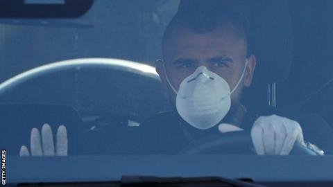 Barcelona's Arturo Vidal arrives at the club's training ground wearing a mask and gloves for a coronavirus test