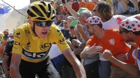 Chris Froome rides up Alpe d'Huez