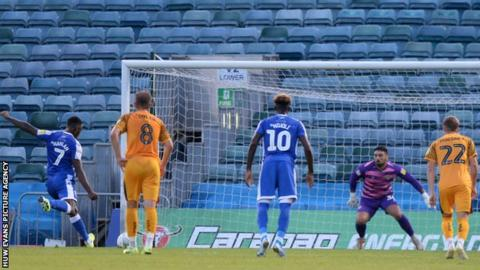 Gillingham's Brandon Hanlon scored his first penalty but saw his second saved by Nick Townsend