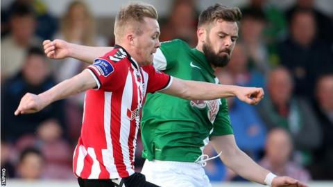 Derry City's Conor McCormack challenges Greg Bolger of Cork City