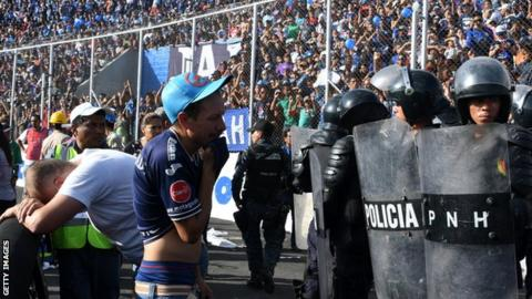 Fans reacts following a stampede during the game between Motagua and Honduras Progreso