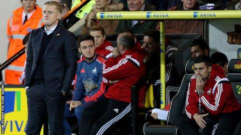 Garry Monk looks on during Swansea's defeat at Norwich