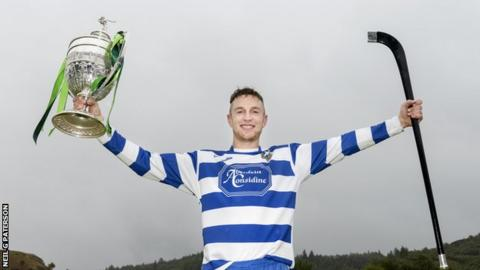 Newtonmore captain Andy MacKintosh holds the Camanachd Cup after his side beat Lovat 3-0